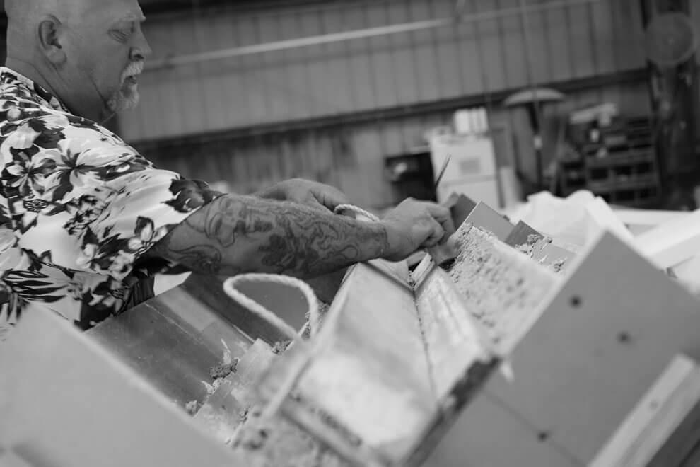 Carpenter Working on L-shape Piece
